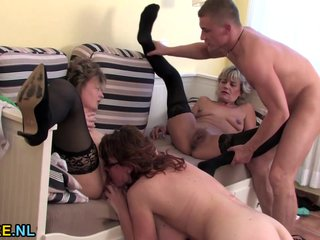Three mature wake up a younger guy