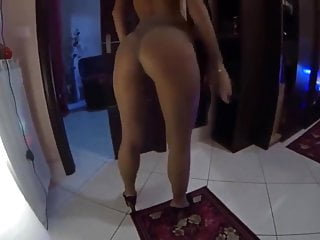 Highly steamy mom displaying her bootie in nylons and high high-heeled shoes