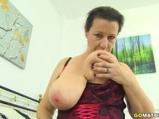 Brit housewife Eva Jayne displaying off her large melons
