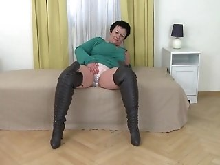 Big busty mom in leather boots masturbates