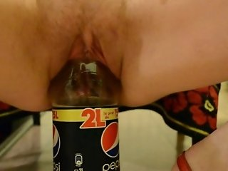 My weird wife masturbates her cunt with a pepsi bottle indoors