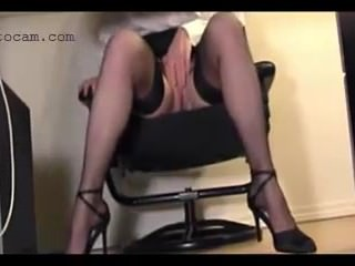 Hidden cam recorded secretary in stockings under the desk