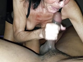 Gilf providing humid hand-job to big black cock