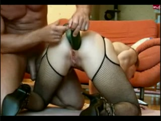 My wife sucks my dick while having two huge cucumbers in her asshole