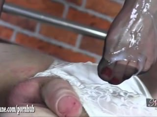 Hot Milf gives silky nylon foot wank until sissy slave cums on sexy feet