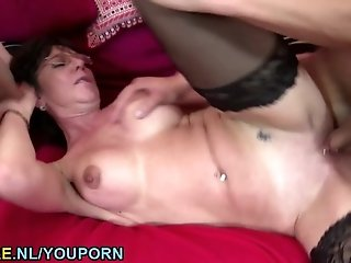 Two studs sharing a natural busty MILF