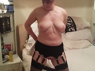 Mature hooker in tight corset shows me what her tits look like