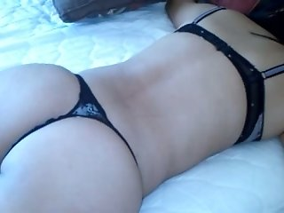 My cute dark-haired wife wearing thong and bra shows her nice ass