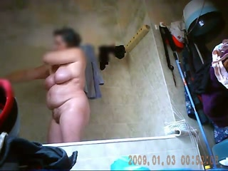 Hidden cam clip with my chubby wife taking a shower and dressing