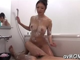Hot asian female parent disrobes with the addition of will not hear of tapering pussy be conscious of fucked