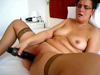 Granny Masturbates with a Big Vibrator