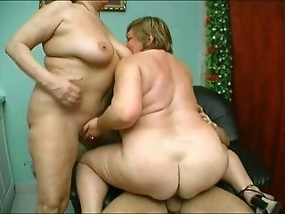 FFM scene with two mature blondes sucking & riding a cock by turns