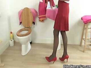 British grannies Elaine and Amanda fuck a dildo on toilet