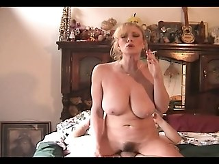 When a busty blonde wife smokes during steamy sex with her husband