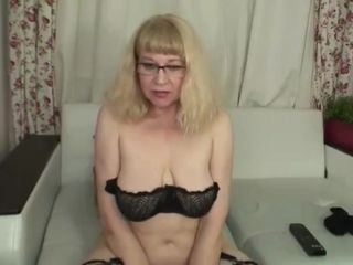 Fur covered grandmother in stockings on webcam