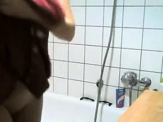 Spying Mom shaving her pussy in the shower