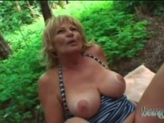 Utterly super-fucking-hot blondie cougar with massive mammories opens up her gams in a woods where she has some joy with a junior stud who then porks